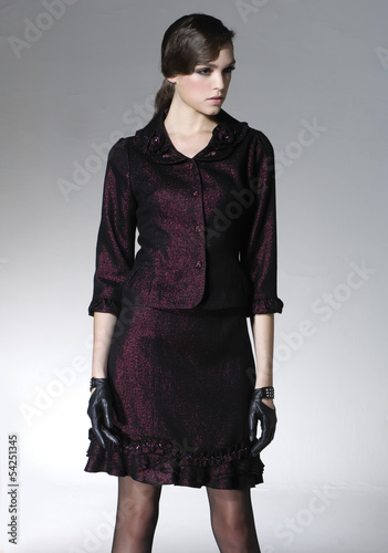 young fashion woman with gloves posing on light background