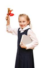 Девочка звонит в школьный колокольчик