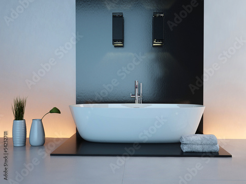 Luxurious illuminated bathroom interior with white bathtub