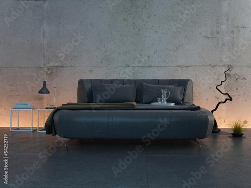 Modern illuminated bedroom with dark bed