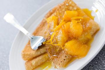 Pancakes with oranges.