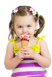kid girl eating ice cream in studio isolated