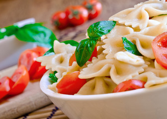 pasta with basil, tomatoes and italian cheese called mozzarella