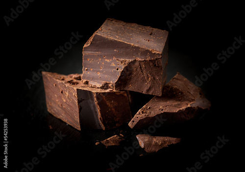 Chopped chocolate on a black background