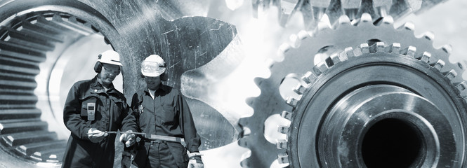 industry workers with giant machinery, panoramic view