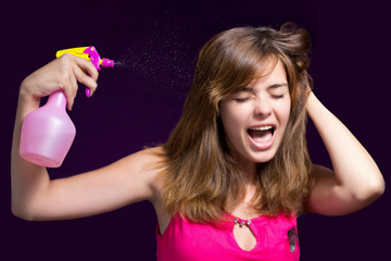 girl tired of cleaning the house, she uses a spray on yourself