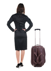 Back view of traveling business woman  with  suitcase.