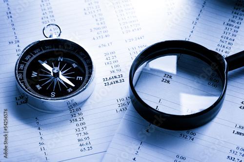 Leinwandbild Motiv Operating budget, magnifying glass and black compass