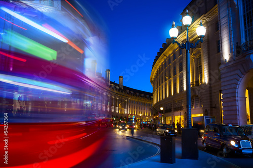 Art double-decker. Piccadilly Circus in London by night