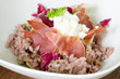 Red wine risotto with fried ham and salad