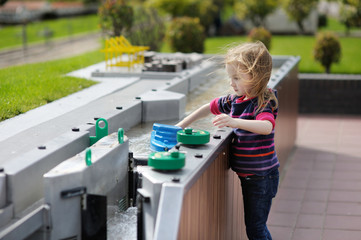 A girl playing with a boat in Madurodam