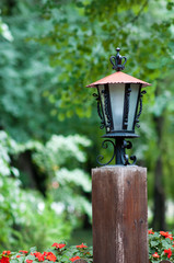 Garden lantern of an old wooden beam