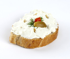 cheese spread with olives on bread
