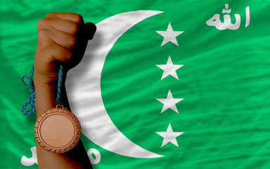 Bronze medal for sport and  national flag of  of comoros