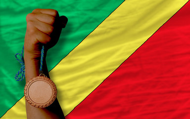 Bronze medal for sport and  national flag of  of congo