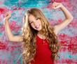 Leinwanddruck Bild - Blond happy children girl in red happy arms up