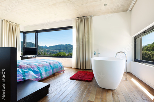 Modern villa, interior, bedroom with bathtub