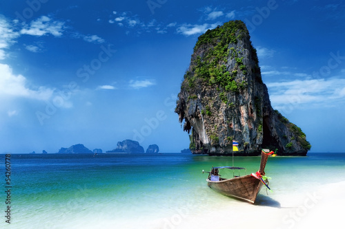 Fotobehang Strand Thailand beach in tropical island. Travel boats at summer in sea