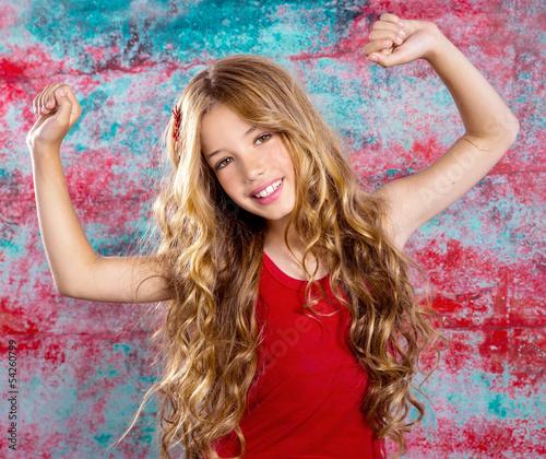 Leinwanddruck Bild Blond happy children girl in red happy arms up