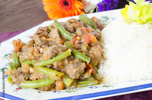 Mexican meat stew with green beans, tomato and rice