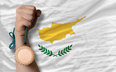 Bronze medal for sport and  national flag of cyprus
