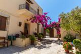Fototapety Branches of flowers pink bougainvillea bush, Crete, Greece
