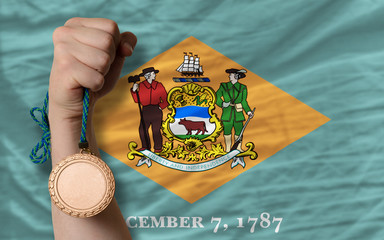 Bronze medal for sport and  flag of american state of delaware
