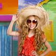 blond children happy tourist girl  beach hat and sunglasses