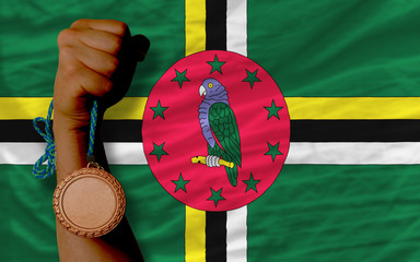 Bronze medal for sport and  national flag of dominica