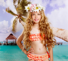 Beach tropical vacation kid blond girl with fashion flowers