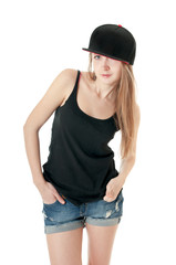 Portrait of a beautiful girl in a baseball cap isolated