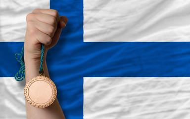 Bronze medal for sport and  national flag of finland