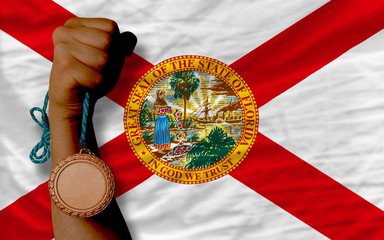 Bronze medal for sport and  flag of american state of florida
