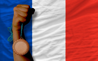 Bronze medal for sport and  national flag of france