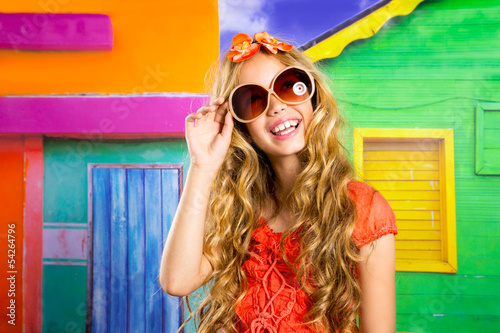 blond children happy tourist girl  smiling with sunglasses