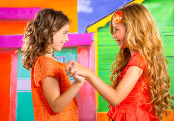 children firends girls in vacation at tropical colorful house