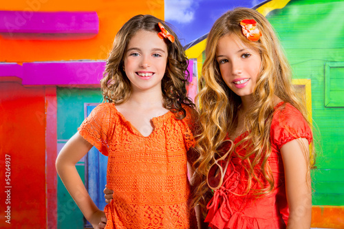 children friends girls in vacation at tropical colorful house