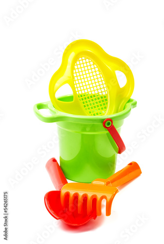 Children's toys  bucket  shovel and  rake on the white