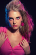 Sensual retro 80s fashion girl with pink dress and long blonde h