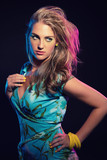 Sexy retro 80s fashion girl with blue tropical dress and long bl poster