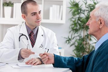 Male doctor with  a prescription