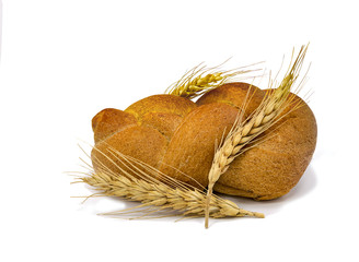Loaf of bread with spickelet of wheat isolated on white