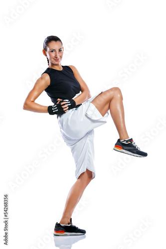 Young woman practicing kicking