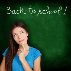 Back to school blackboard - woman student thinking