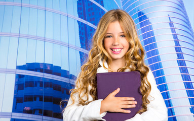 Children business student girl with tablet pc on urban buidings
