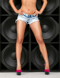 Sexy legs over wall of speakers