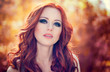 Outdoors portrait of beautiful woman with red hair