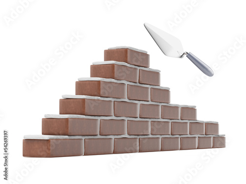 Trowel and brick wall