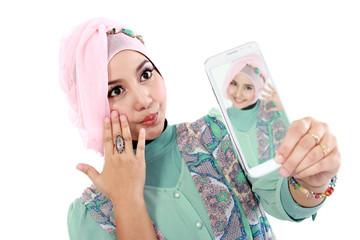 Happy young muslim woman take self portrait