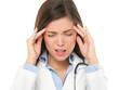 Doctor with headache stressed